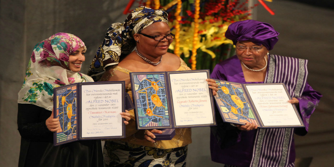 Image Credit: Tawakkul Karman, Leymah Gbowee and Ellen Johnson Sirleaf display their awards during the presentation of the Nobel Peace Prize, 10 December 2011 (Harry Wad)