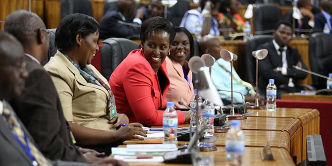 Attendees share a joke at the Umushyikirano 2013, a National Dialogue platform where for two days, policy makers and leaders of government institutions are put on the spot to face performance assessments from the public  Credit: Rwanda Government via Flickr (http://bit.ly/1JYawCn) CC BY-ND 2.0
