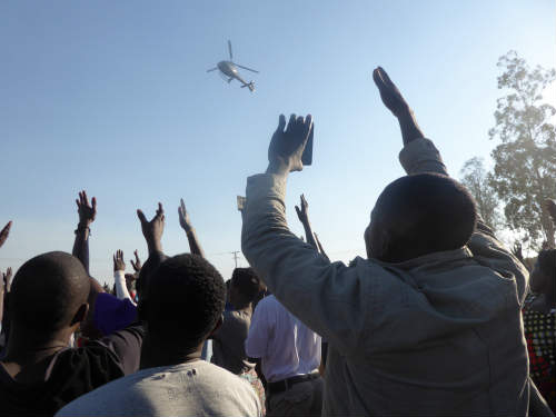 Zambian mobile phone users taking photos of helicopter landing of UPND's presidential candidate, Hakainde Hichilema at a rally in Mandevu, Lusaka Photo Credit: Wendy Willems