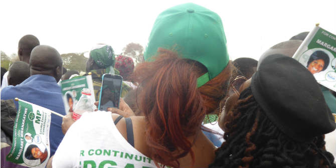 PF supporters posing for a selfie during a political rally in Woodlands stadium, Lusaka Photo Credit: Wendy Willems