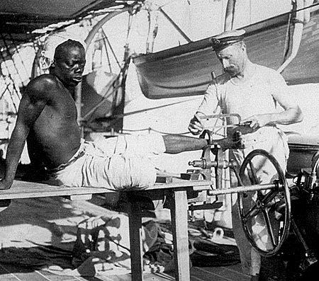 """Freeing a Slave from his Shackle on HMS 'Sphinx' off the East Coast of Africa 1907"""
