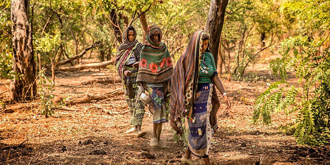 Peuhl women walk to their camp in the forest around Ndele