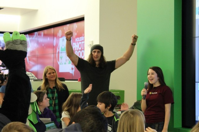 "Willson celebrates with students after they figured out how to code an ""if"" statement during an Hour of Code at the Microsoft Store in Bellevue, Wash."