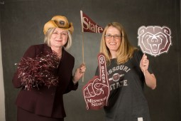 Tara and Michelle holding up MSU swag