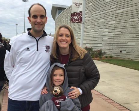 Tara and Kyle Calton outside JQH Arena with their daughter.