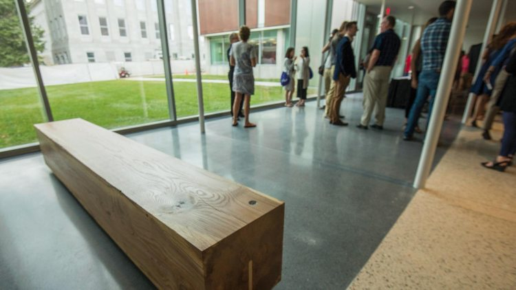 Wood bench inside Ellis Hall