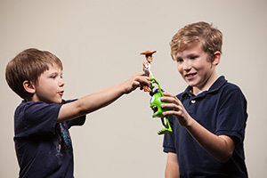 Boys playing with toys