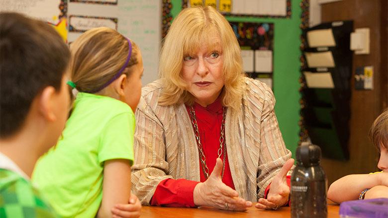 Dr. Julie Masterson talking with children