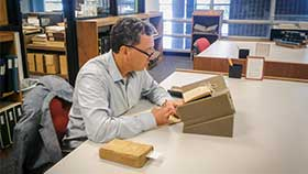 Dr. Eric Nelson studying a text