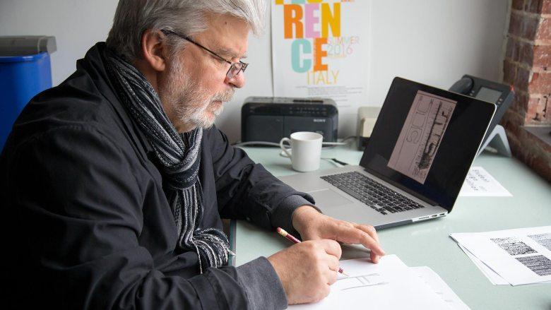 Cedomir Kostovic sketching next to his laptop