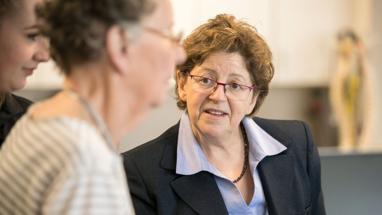 Dr. Susan Robinson listening to patient