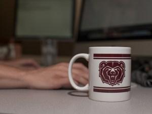 Blogger with Missouri State coffee mug