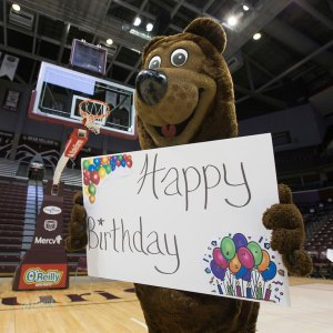 Boomer with happy birthday sign in gym