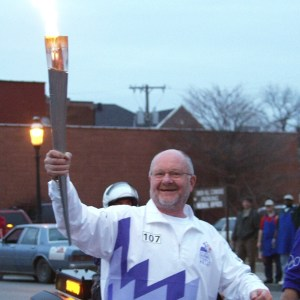 Peter Herschend carrying torch