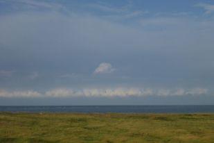 Wolke steigt durch Dunst (Foto: Tore J. Mayland-Quellhorst).