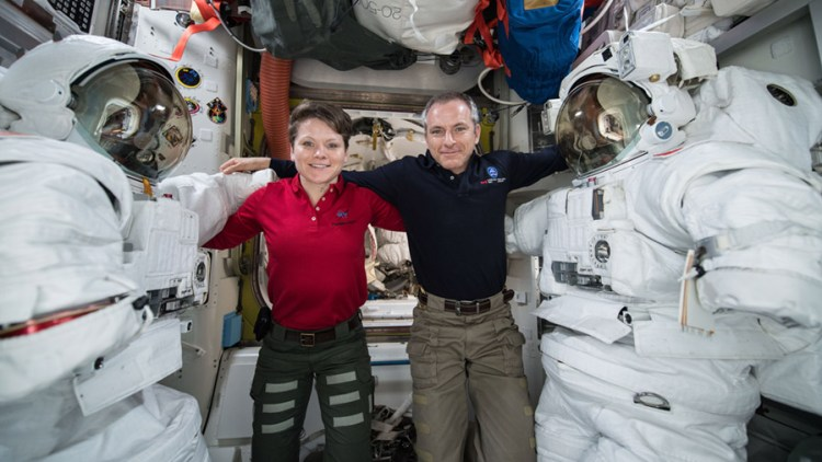 Astronauts (from left) Anne McClain and David Saint Jacques