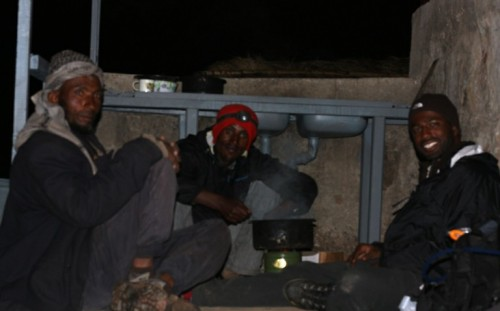 Making dinner with Idris and Kadir huddled near the wolf project's vacant field site