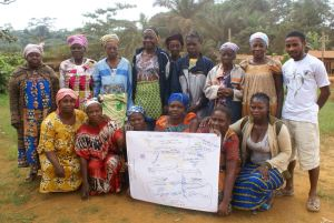 A colorful group of women, with their colorful community map of Ntsibelong.