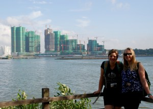 Aurora and Victoria pose with Johor Malaysia in the background.
