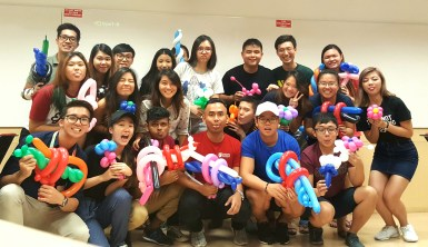 Students learning how to do balloon sculpting with a trainer from THAT Balloons.