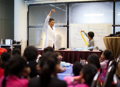The scientist showed how magic tricks were done using simple science knowledge.