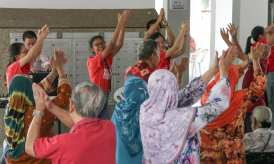 Leading a Zumba session to promote an active lifestyle.