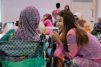 Volunteer and macik (an elderly aunty in malay) enjoying a conversation.