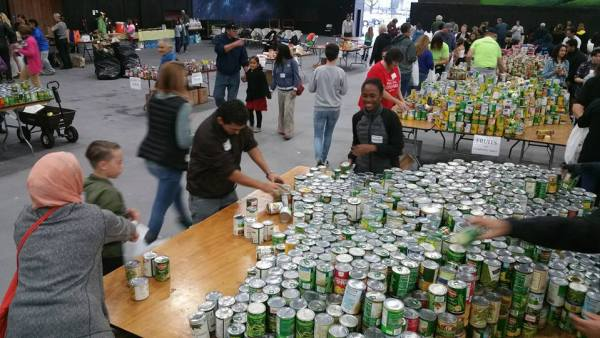 organizing cans for food drive