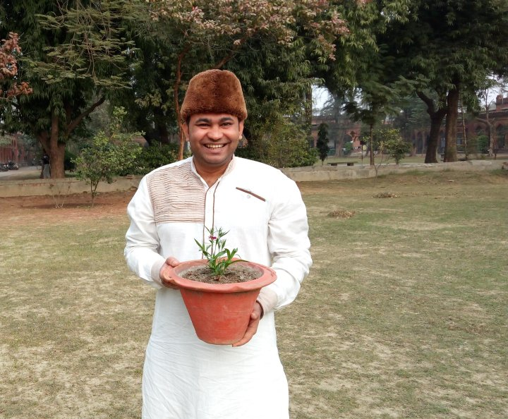Sheth Zulfiqar stands with his #CCISeeds plant.