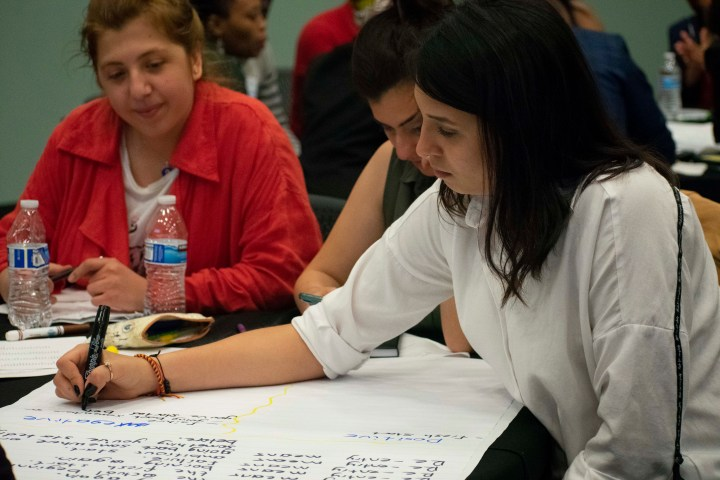 participants writing during the culture shock workshop