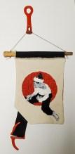 "16. Izabo Pintando, Embroidery on canvas, Wooden tool handle, Denim, Cast Iron Hooks, 13"" x 27"", $750"