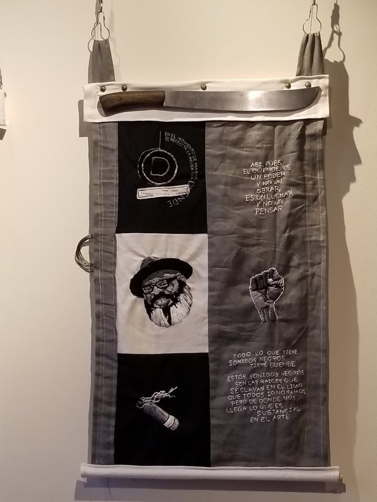 """22. The Poet Search for Duende, Embroidery on denim and linen with faux machete, 32"""" x 20"""" , $1,200"""