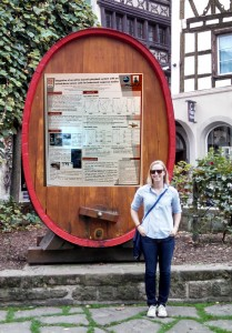 Pretend this is me in front of my poster at the conference instead of a giant wine  barrel.