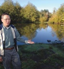 Sam Chan standing next to body of water