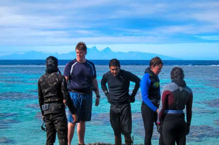 Part of the Gump team with Mo'orea in the background