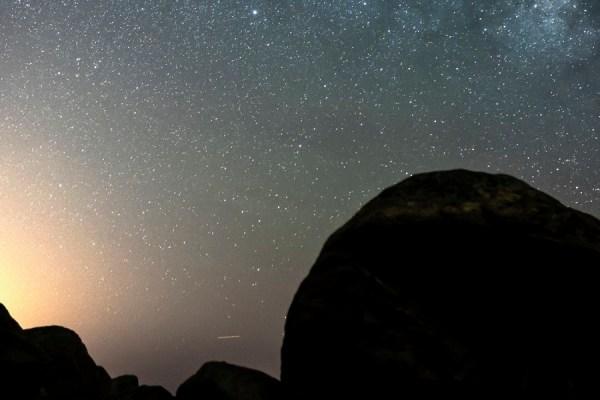 Man Looking At The Milky Way Galaxy