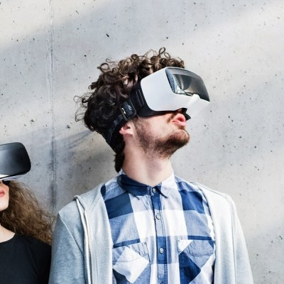 Portrait Of Young Students With Vr Goggles In A Library.