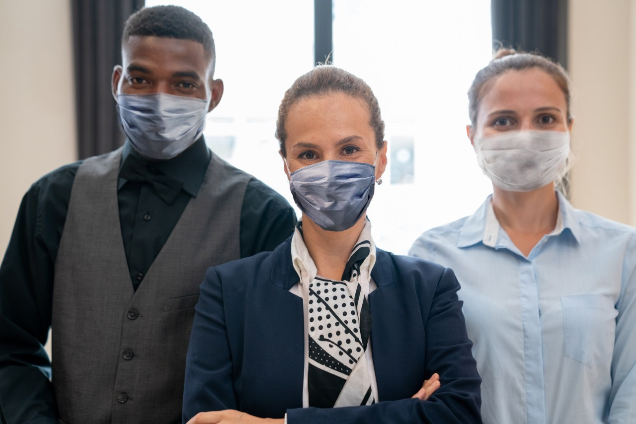 Portrait Of Multi Racial Hotel Staff Wearing Protective Masks
