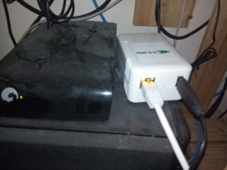 Photo of rather dusty, but working, pluggy the plug computer and its attached drive working as file server etc.