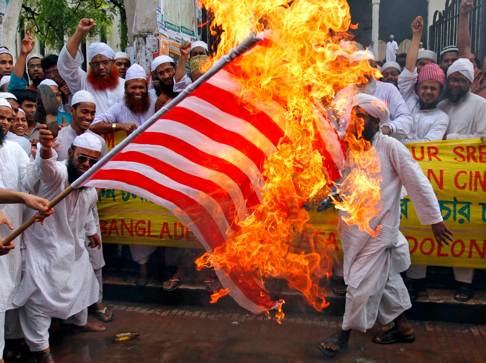 Muslims burning down an American flag