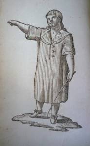 frontispiece of a boy wearing what looks like a long night shirt