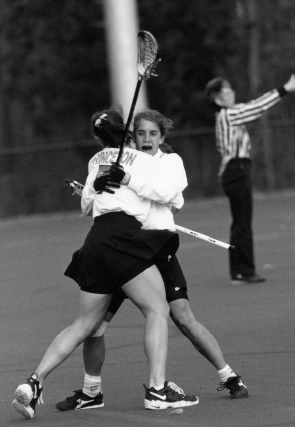 Women's_Lacrosse_hug_undated_AC112_BoxAD36_Folder_2
