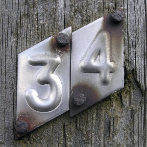 metal house number (34) with rusted nails, photo by LEOL30 on Flickr