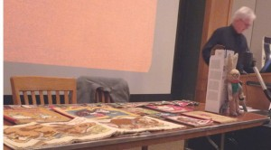 Peter Cope displaying Oswald, the Lucky Rabbit and select Dean's Rag Books.