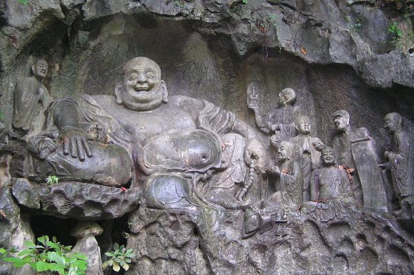 Maitreya_and_disciples_carving_in_Feilai_Feng_Caves