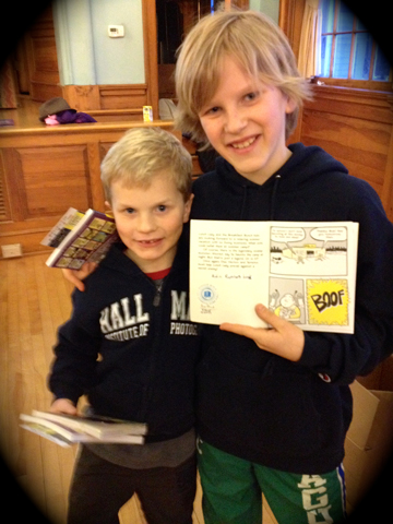 Vermont's youngest librarians, showing off their newest acquisition, Jarrett J. Krosoczka's Lunch Lady and the Schoolwide Scuffle.