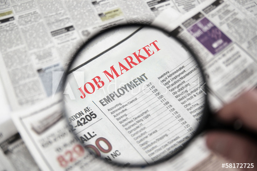 Magnifying glass over newspaper entitled Jobs Market