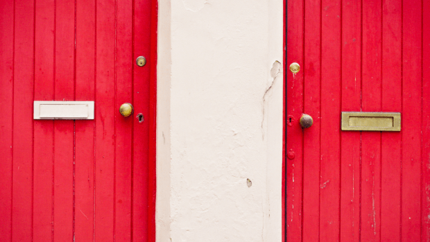 Two red doors next to eachother