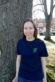 Portrait: Isobel vernon next to tree