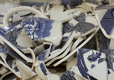 An image of decorated cracked/broken crockery